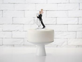 Svatební figurky nesoucí se nevěsta